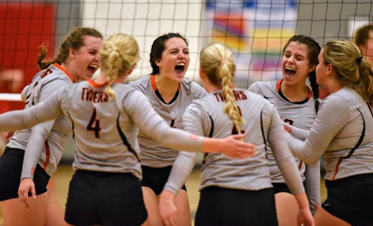 St. Cloud Tech players celebrate a point during the Tuesday, Sept. 4, game at ROCORI High School in Cold Spring. Tech swept the Spartans in the match.