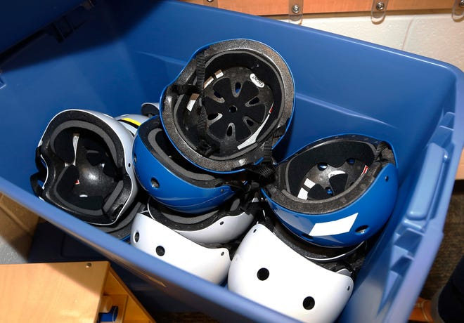 Safety helmets are stored in a container in a pre-K classroom at an elementary school in Oklahoma. Comprehensive new children's concussion guidelines from the U.S. government released on Sept. 4, 2018, recommend against routine X-rays and blood tests for diagnosis and reassure parents that most kids' symptoms subside within one to three months.