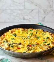 A frittata is cooked in an oven-proof skilled and finished in the oven.