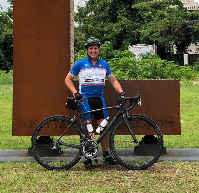 "Patrick Conn is biking as part of the ""Coast 2 Coast 4 Cancer"" ride to raise funds for researching the disease. He lost his daughter to cancer in 2007."