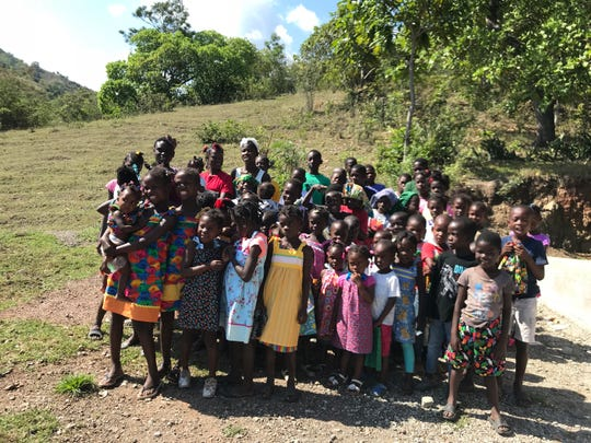 Haitian children proudly wear the new closes created by the The MFI Sewing Ladies and delivered by Missionary Flights International.