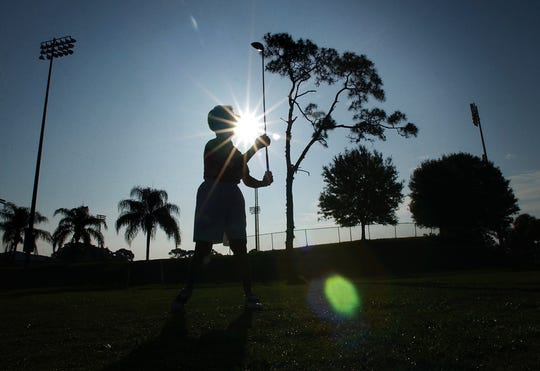 Eve Huson, of Vero Beach, hits the second shot of her last round of golf at the Dodgertown Golf Club while  playing with other members of the Women's Golf League. May 24, 2003, was the last day of operation at the nine-hole golf course next to Holman Stadium.