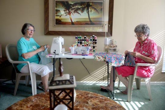 """Ursula Moses (left) and Lee Harris work on constructing handmade shorts for children in Haiti on Wednesday, Sept. 5, 2018, during a bi-weekly sewing group in Spanish Lakes Country Club Village in St. Lucie County. """"Our sewing group has been going for five years and we started it because a lot of the ladies who wanted to volunteer their time at Missionary Flights International or within the church who know how to sew would be able to bless the children of third-world countries,"""" said Jeanette McLaughlin, organizer of the group. """"It's an outlet to serve God but also to do something that was useful."""" Every other Wednesday, the group convenes to sew dresses, skirts and shorts for children in Haiti, which then is given to Missionary Flights International to distribute."""