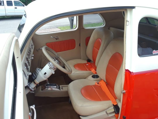 Custom seats tie the car's interior to the exterior decor. The rest of the customized interior was created and installed by Tops of Micco, FL.