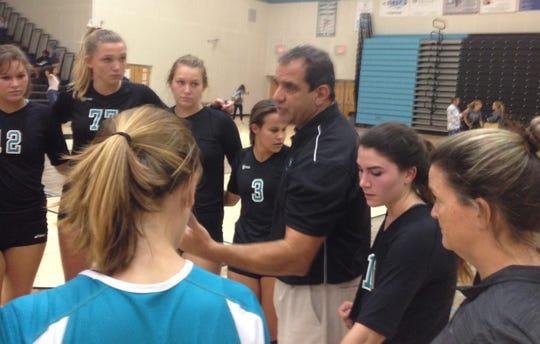 Jensen Beach volleyball coach Mike Sawtelle (center) talks to players after a five-set win Tuesday, Sept. 4 against St. Lucie West Centennial at Jensen Beach.