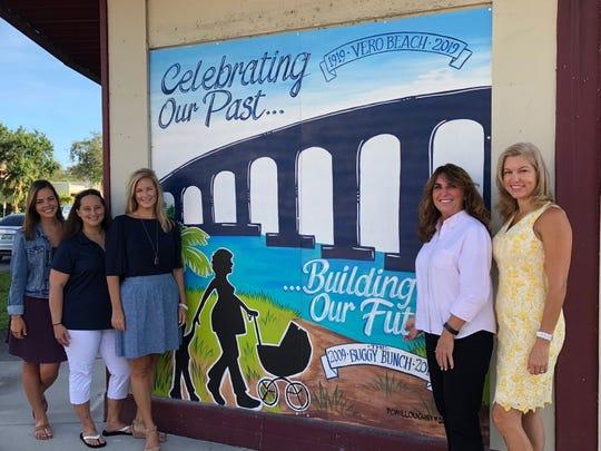 Buggy Bunch staff unveils the new Family Education Center mural: Grace Imler, Kim Metz, Tara Wright, Cori Lamm and April Muller.