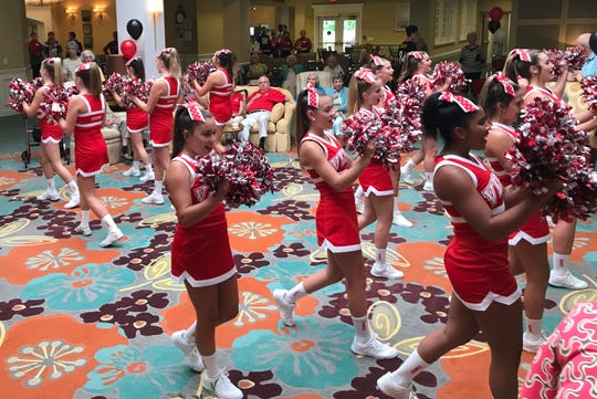Vero Beach High School cheerleaders perform Aug. 10 at a pre-season pep rally for residents at Indian River Estates, a retirement community in Vero Beach.