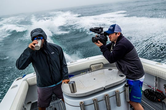 Nick Verola, right, at work in the Pacific Ocean out of San Diego.