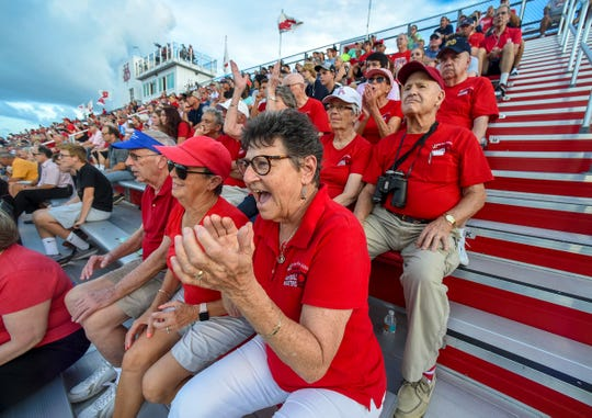 Avid Vero Beach High School football fan Ann Ohlrich cheers for the team Friday, Aug. 31, 2018, along with fellow Indian River Estates residents during Vero Beach's game against Wellington at Vero Beach High School. To see more photos, go to TCPalm.com.