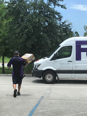 The FEDEX driver carries away the most precious package, to send it on its way to the troops.