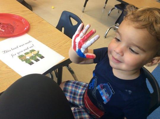 John Glenn Stallings is ready to create his masterpiece -- a flag handprint.