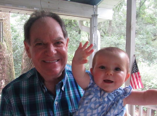 Jack Levine, also known as Pop Pop Jack, holds his 9-month-old granddaughter, Julianne Levine.