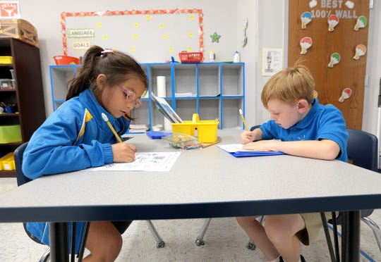 Students at IDEA Edgemere work on an assignment at the campus, which opened this school year in far East El Paso.