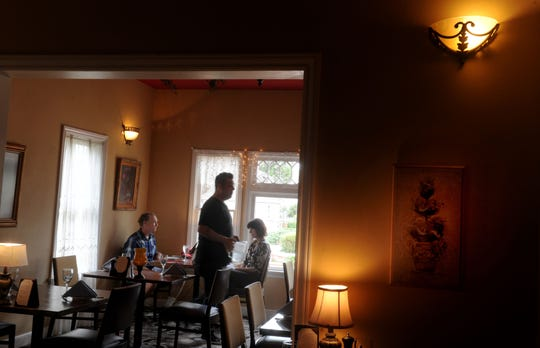 Jim David and Gale David order their food from server Joe Vierra, center, at La Dolce Vita in Oxnard's Heritage Square.