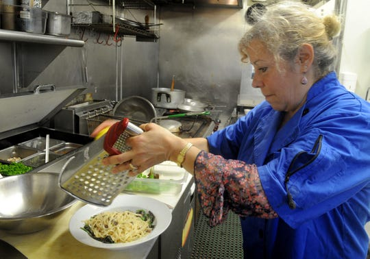 Michelle Kenney prepares her lemon pistachio pasta at La Dolce Vita restaurant in Oxnard. Kenney and her husband, Greg, have operated the restaurant at Heritage Square for 13 years and in May purchased the property.