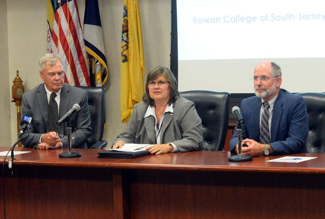 Rowan College at Gloucester County president Frederick Keating (left), Cumberland County College president Shelly Schneider and merger liaison Robert Clark, discuss a details of a potential joinder of the two schools.