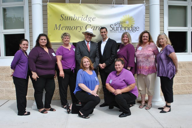 Owners and staff members celebrate the recent opening of the Sunbridge Memory SupportProgram atSpring Oak of Vineland.