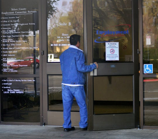 In this file photo a man walks into Employment Connection in Visalia.