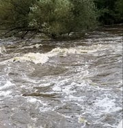 The Rib River continues to rise near State 107 west of Wausau.