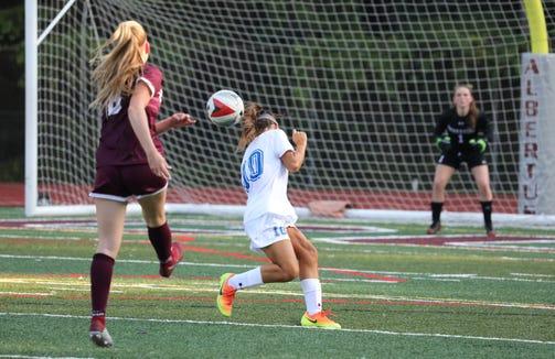 Albertus Magnus' Julianna Hanigan shoots on goal past Bronxville's Victoria Ruffo during their game at Albertus Sept. 5, 2018.
