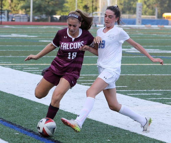 Albertus Magnus' Colette Martucci, left, is pressured by Bronxville's Maeve Sullivan during their game at Albertus Sept. 5, 2018.