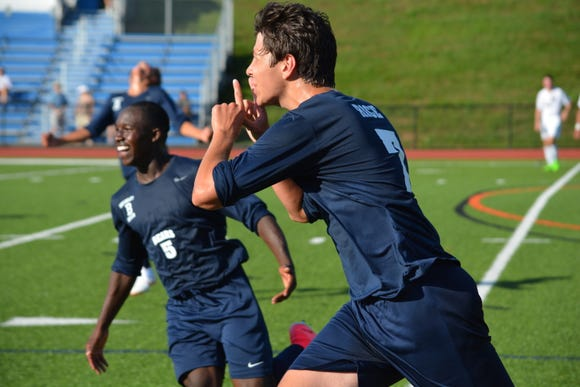 Briarcliff forward Will Rice (7) celebrates his goal in the closing minutes of the first half Tuesday against Pleasantville in the opening round of the Mount Pleasant Cup.