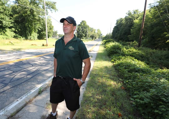 Glenn Griffin stands along Broadway, near the site of his proposal for affordable housing in Buchanan, just north of the intersection of Bleakley Avenue.