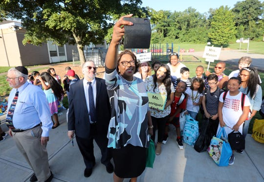 East Ramapo Central School District Superintendent Deborah Wortham, takes a selfie with Board President Harry Grossman, students and teachers on the first day of school at Kakiat Elementary School Sept. 5, 2018.
