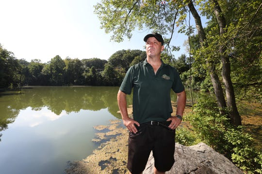 Glenn Griffin stands near a pond on the site of his proposal for affordable housing in Buchanan, just north of the intersection of Bleakley Avenue and Broadway.