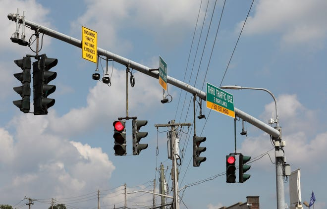 Cameras are positioned between traffic lights on a pole along Westchester Avenue and South Kensico Avenue in White Plains, Sept. 5, 2018.