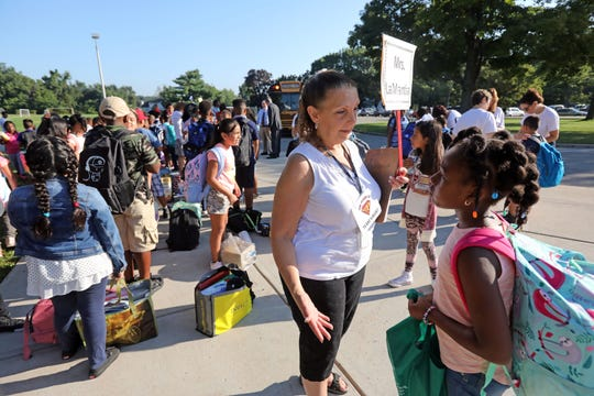 Fourth-grade teacher Andrea LaMantia welcomes an apprehensive student on the first day of school at Kakiat Elementary School Sept. 5, 2018.