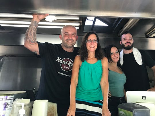 Lohud food reporter Jeanne Muchnick, second from left, on The Souvlaki Truck in Yonkers with, from left owner/chef George Kringas, Christina Mancuso and Kyle McNulty. Photographed August 28, 2018.