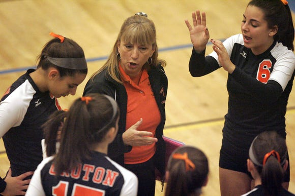 Croton Harmon head coach Robin Cooke talks to her team during a timeout of the girls varsity Class C final volleyball game between Westlake and Croton Harmon at Pelham High School Oct. 31, 2008.