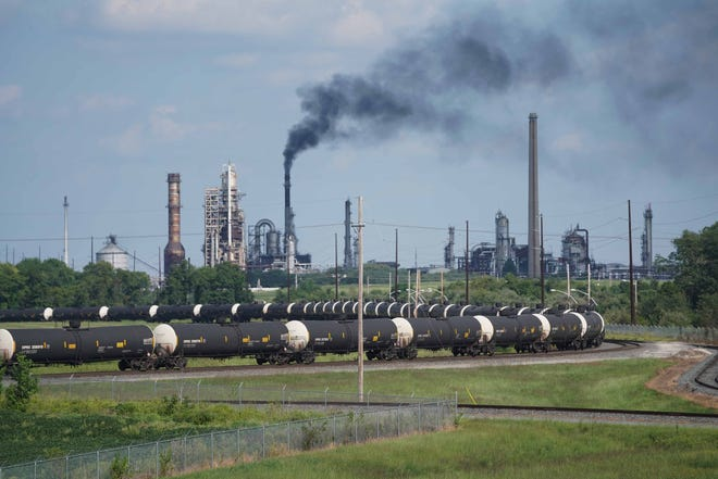 Black smoke is omitted from a stack on the ground of the Delaware City Refinery.