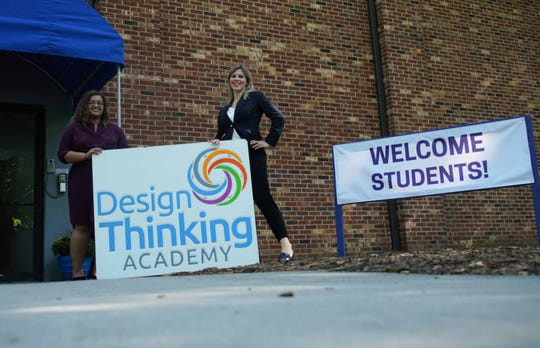 (left to right) Samaira Sirajee, a school data analysis, and Stephanie Silverman, principal of Design Thinking Academy, hold a then- new sign for the school formerly named the Delaware Design Lab High School in September 2018.