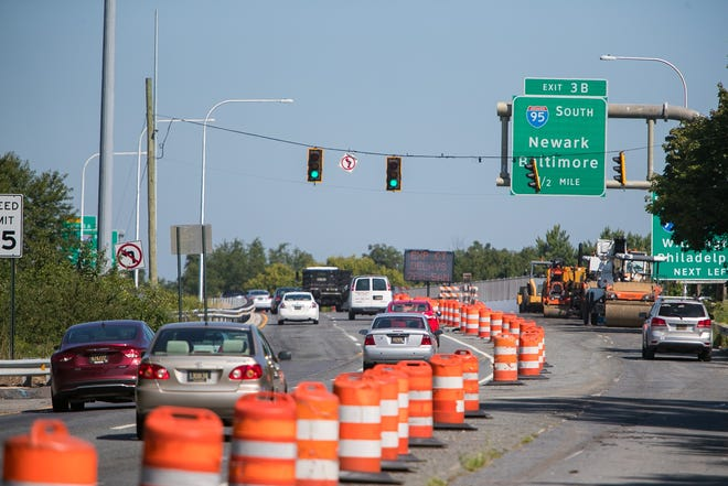 Northbound traffic moves along Route 141 and Airport Road as construction continues.