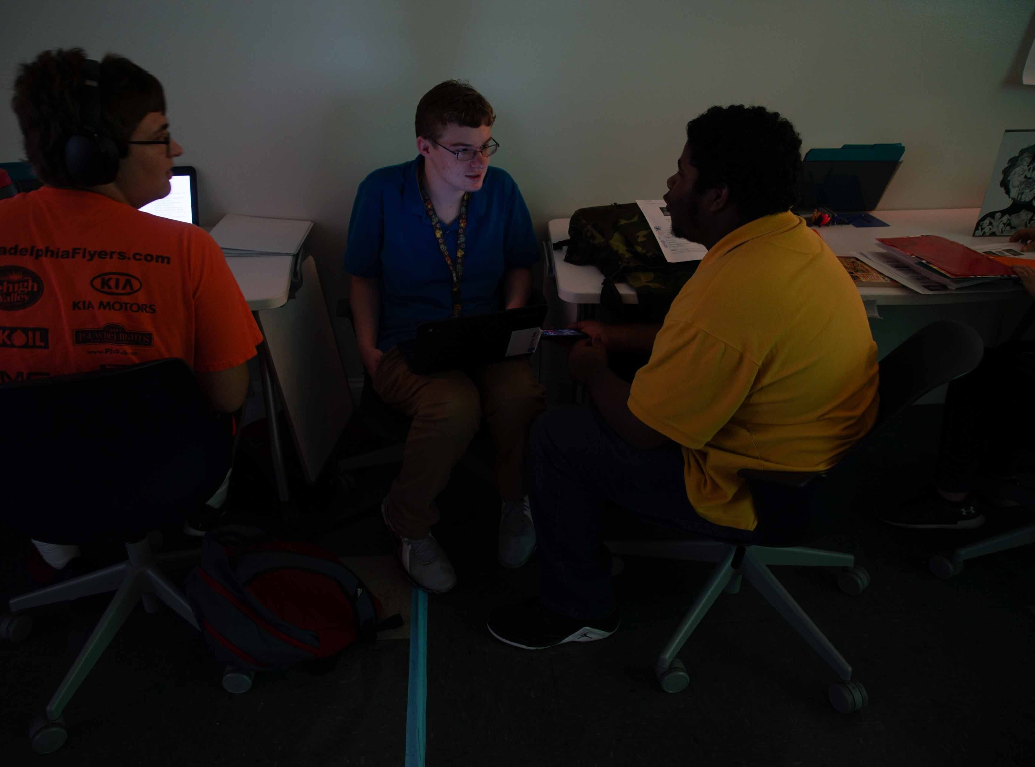 Nick Moore, 17, works with his classmates in his psychology class at the Design Thinking Academy.