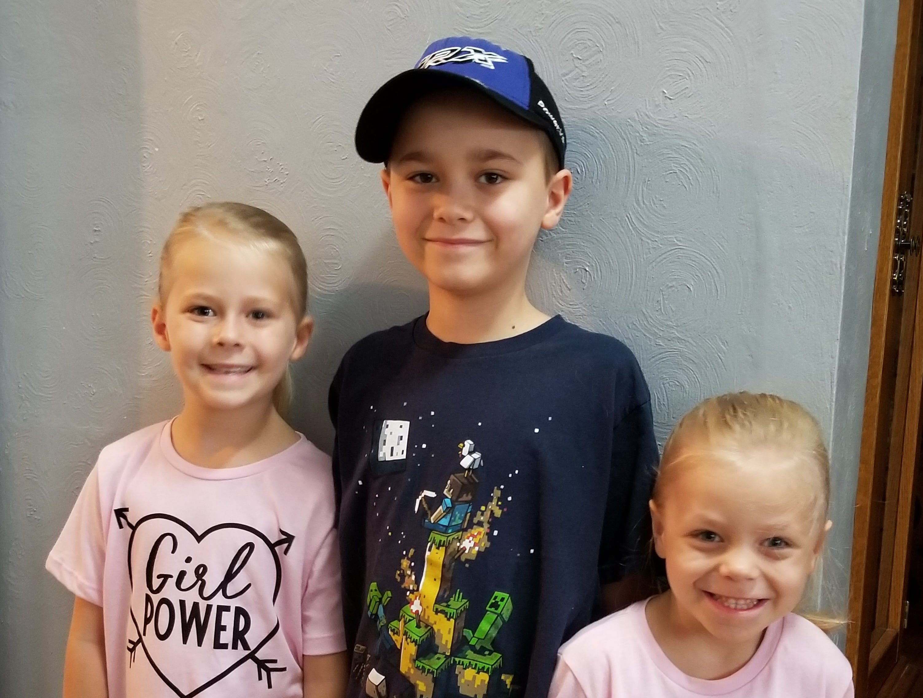 Savannah Schmelzer, Rowan Schmelzer and Amber Schmelzer on their first day of the new school year at Port Edwards Elementary School. Savannah is in second grade; Rowan is in third grade; and Amber is in 4K. Their parents are Jeff and Kris Schmelzer of Port Edwards.