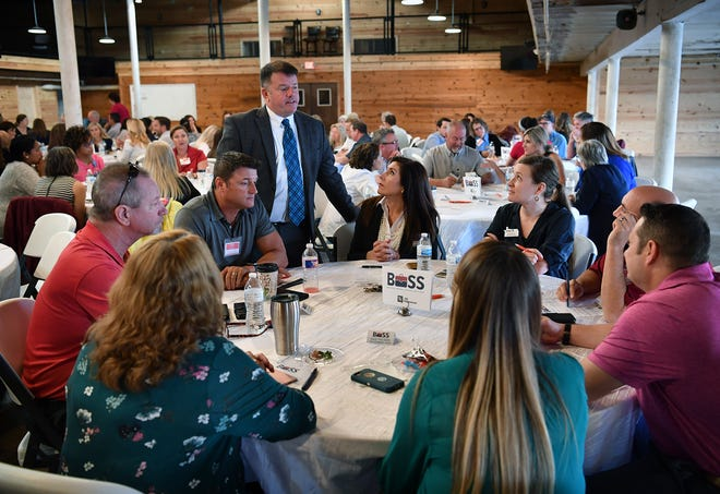 Henry Florsheim, president of the Wichita Falls Chamber of Commerce, visits with attendees during a team building event at The Warehouse Wednesday morning.
