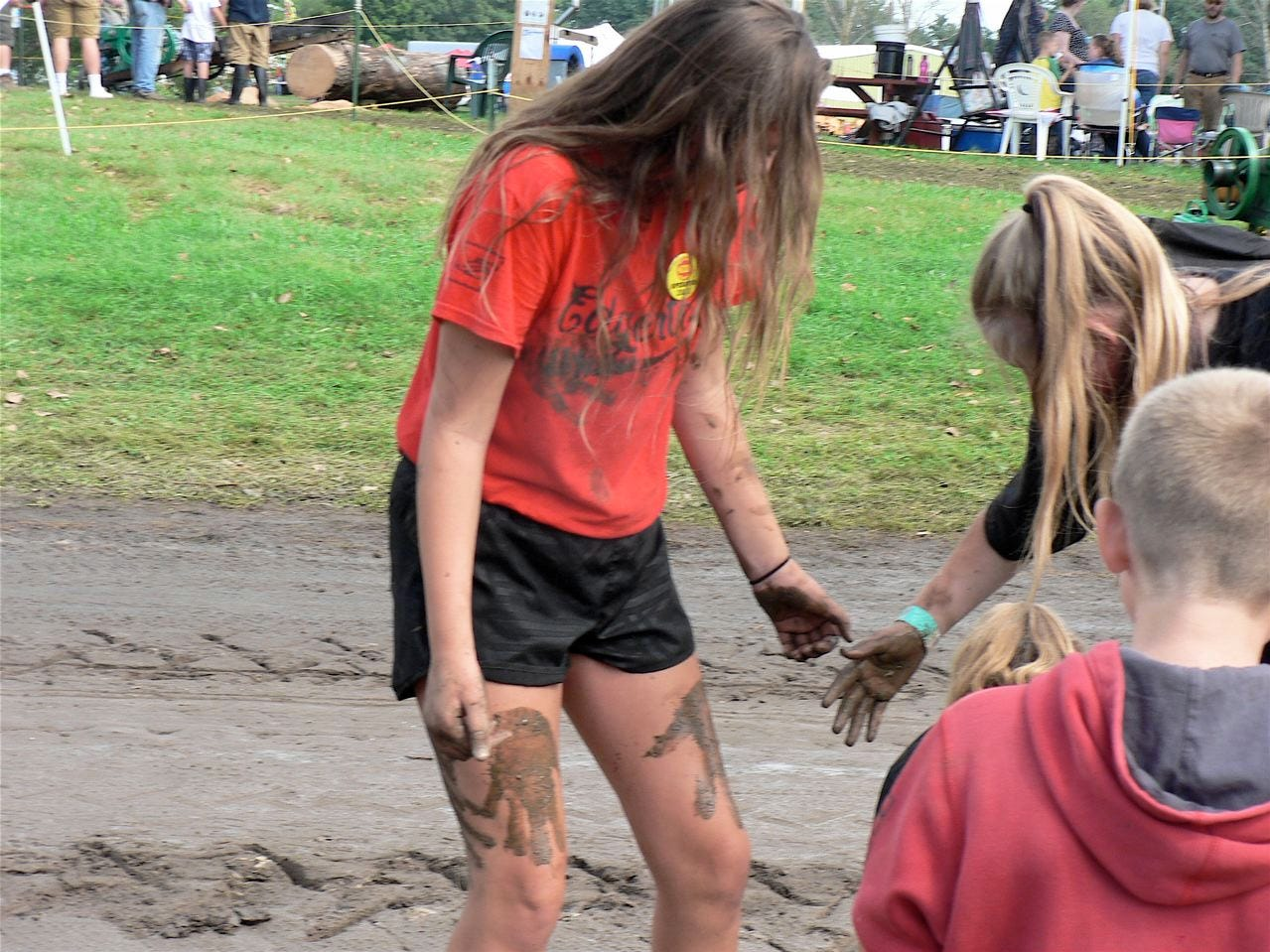 Even not-so-young girls play in the mud at the Thresheree.