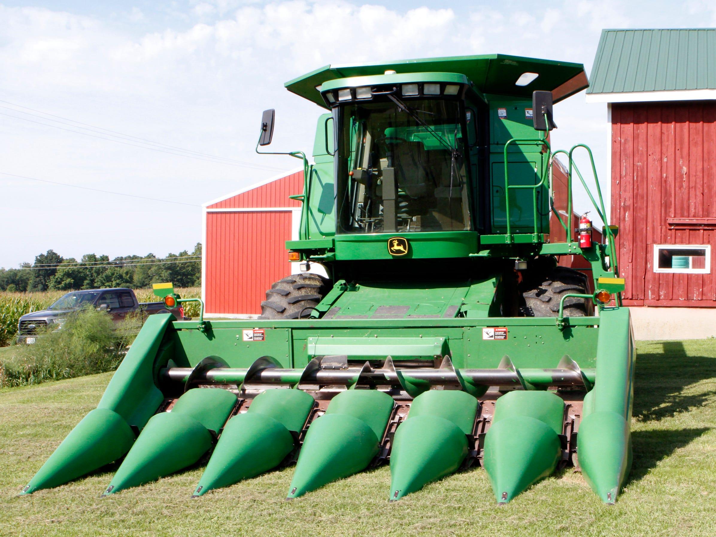 A corn picker head has markings on each side of the head.