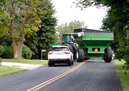 Drivers need to be aware of farm equipment making left turns.