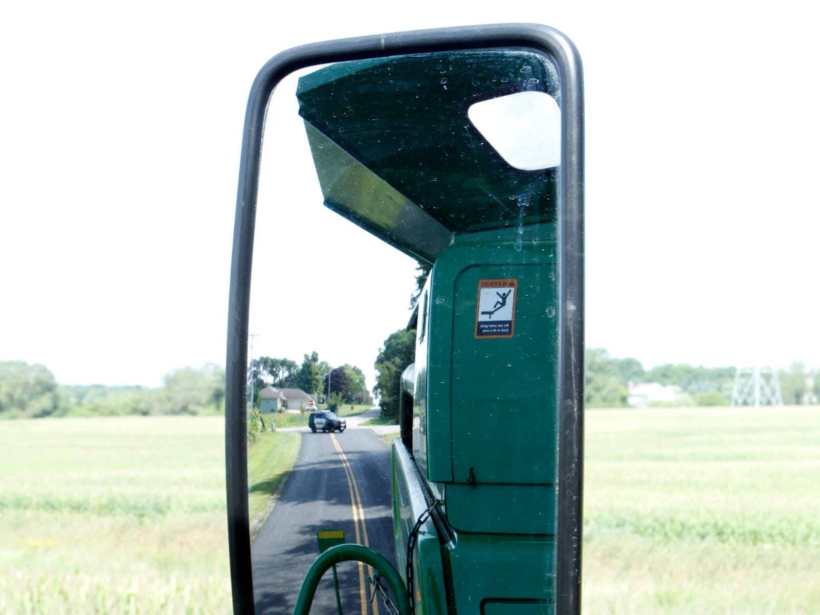 A rear-facing mirror helps equipment drivers see traffic behind them.