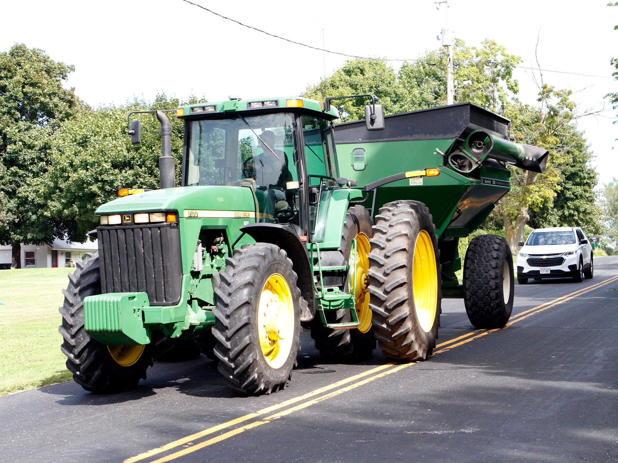 It is illegal to pass farm equipment in a no passing zone.