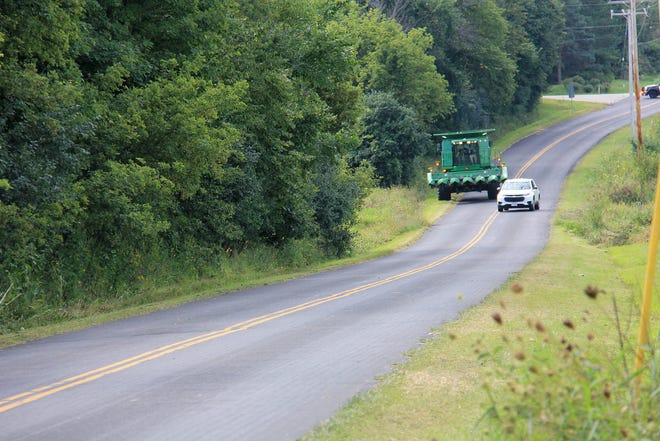 Passing farm equipment in a no-passing zone is illegal. Motorists should wait for a passing zone before attempting to go around slow moving vehicles.