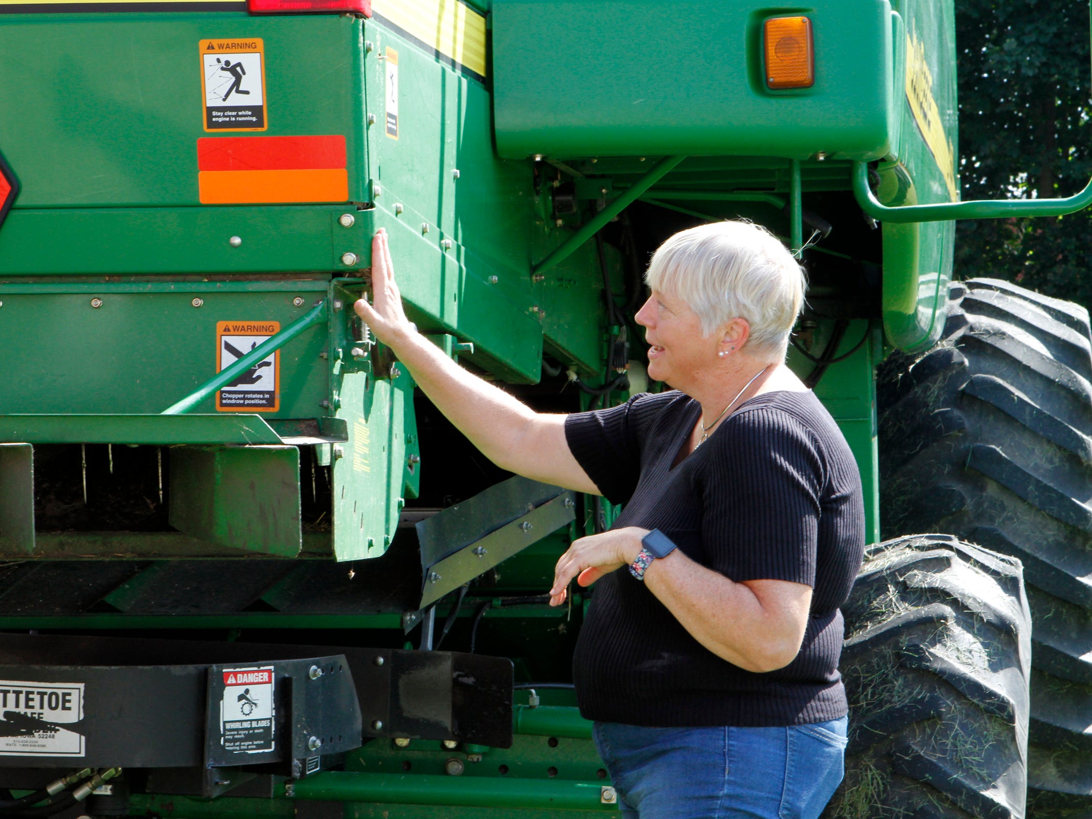 Cheryl Skjolaas, UW-Extension agriculture safety specialist, talks about proper marking of equipment during a road safety demonstration on Aug. 31.