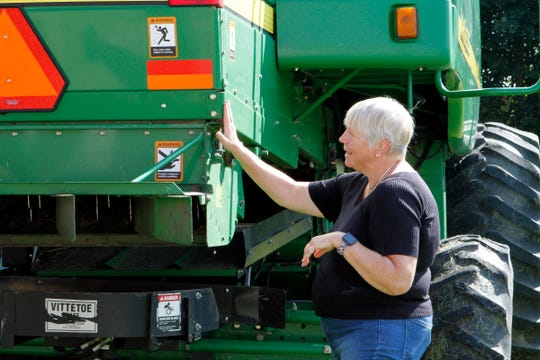 Cheryl Skjolaas, UW-Extension agriculture safety specialist, talks about proper marking of equipment during a road safety demonstration on Aug. 31, 2018.