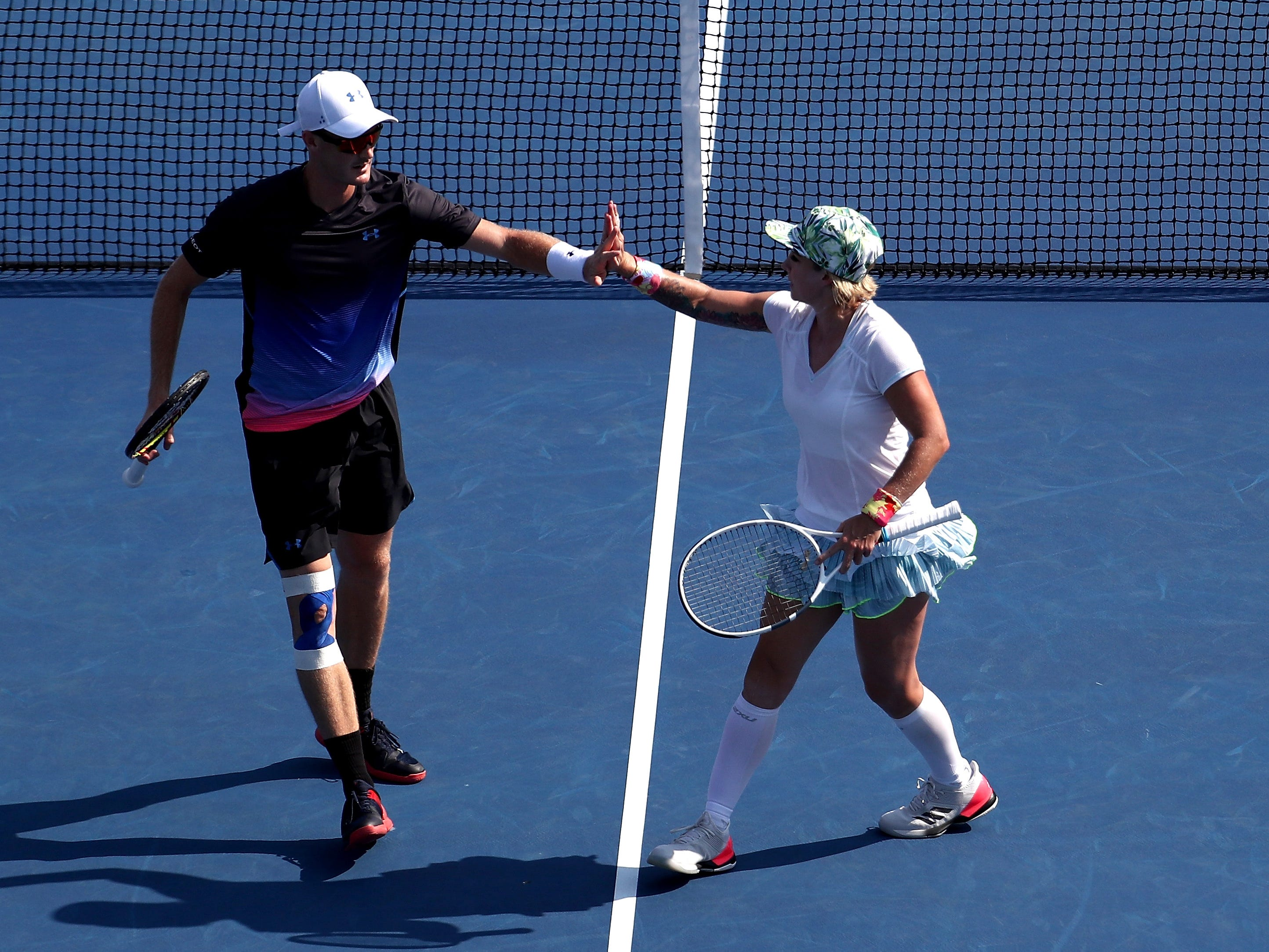 Great Britain's Jamie Murray, left, and the USA's Bethanie Mattek-Sands celebrate a point during their 6-4, 2-6 (10-8) victory over Christina McHale and Christian Harrison in the mixed doubles semifinals.