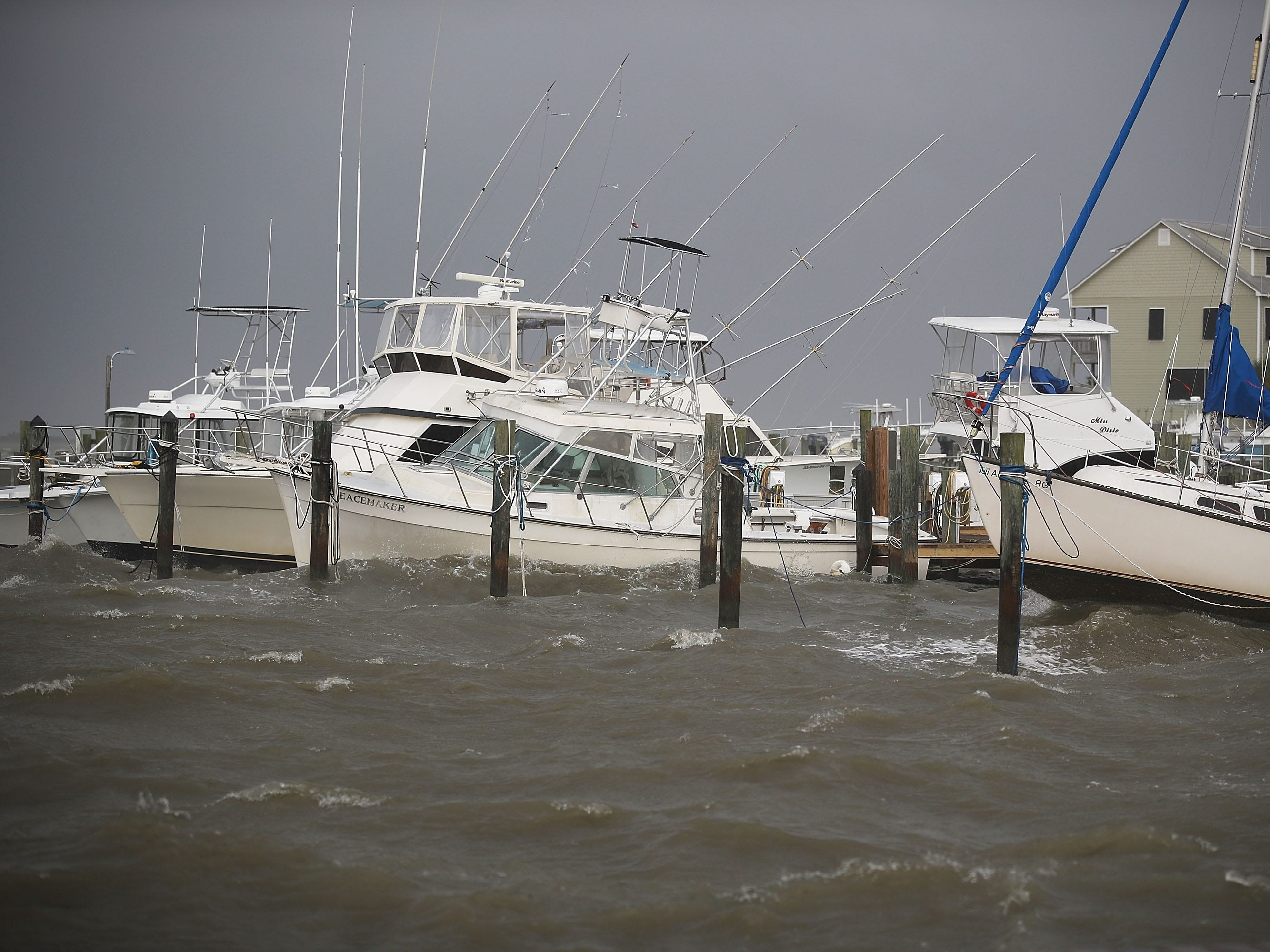 DAUPHIN ISLAND, AL - SEPTEMBER 04:  Boats ride out the incoming waves and rain from Tropical Storm Gordon on September 4, 2018 in Dauphin Island, Alabama.  Gordon heads for the northern Gulf Coast area as a strong tropical storm and could possibly strengthen into a Category 1 hurricane.  (Photo by Joe Raedle/Getty Images) ORG XMIT: 775220251 ORIG FILE ID: 1026756394