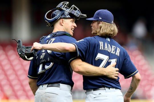 Brewers catcher Erik Kratz celebrates with relief pitcher Josh Hader after a win against the Reds in Cincinnati.